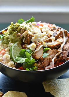 Chipotle-Pesto Chicken Burrito Bowl with Cilantro Lime Rice or Quinoa.  YUM!  Super flavorful, and tastier than you can get from Chipotle! |...
