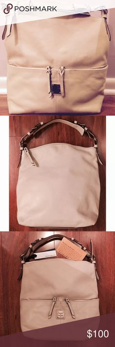 """DOONEY & BOURKE-BONE-MED POCKET SAC HANDBAG-TOTE BONE DOONEY & BOURKE MEDIUM POCKET SAC HANDBAG.  ORIGINAL RETAIL $235 IN GREAT CONDITION ON THE OUTSIDE WITH SOME DISCOLORATION AND SOME STAINING ON THE INSIDE.  LOOKS NEW ON THE OUTSIDE.  COMES WITH THE ORIGINAL TAG.  PERFECT FOR THAT GO TO BAG. ROOMY BUT VERY STYLISH!   TWO OUTSIDE ZIPPER POCKETS.  APPROXIMATELY 14 1/2"""" TALL BY 15"""" WIDE.  THIS BAG IS PRE-OWNED AND LOVED.  I WILL BE HAPPY TO ANSWER ANY QUESTIONS! THANK YOU FOR SHOPPING MY…"""
