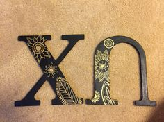 Gold paint pen on black paint. Easy to do. Chi Omega letters. Painted wooden sorority letters.