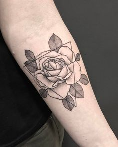 Rose tattoo on the inner forearm.