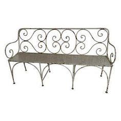 """This rustic, french vibe-y iron bench can be used indoors or out. Note from the seller: I had it at the end of a king size bed and it was perfect. The distressed paint achieved over time gives it it's nice vintage look. The scroll back and seat pattern are unique. The seat height is 17""""."""