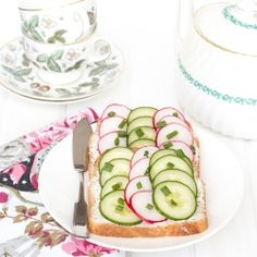 These tasty Tea Sandwiches are filled with cream cheese and top with cucumbers & radishes. Yum!
