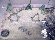 """Make a 'Winter Wonderland Sensory Tray' using rice, flour, sugar, christmas tree cutters, a pot of glitter, pipe cleaners, beads, tinsel, ribbons & christmas decorations ("""",)"""