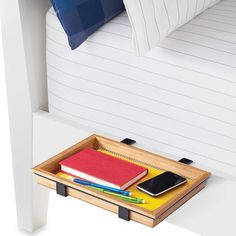 A bed shelf for people in the top bunk who need to have their phone, Chapstick, a water bottle, and several snacks within reach at all times. 31 Products That Will Make Your Dorm Room Feel Like Home Bunk Bed Shelf, Bedside Shelf, Wood Bunk Beds, Bed Shelves, Bedside Storage, Lofted Beds, Bedside Tables, Glass Shelves, Dorm Storage