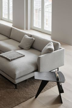 The look is simple and serene in this expansive Calmo sofa, where straight lines converge with discrete curved details. Comfy cushions complete the picture in this understated expression of elegance. Here paired with Magazine Table by Jens Risum. Magazine Table, Straight Lines, Leather Furniture, Chrome Plating, Terrace, Living Spaces, Stool, Cushions, Comfy