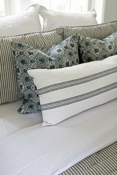 "The (Pottery Barn) bedding was all purchased on eBay. The quilt is ""Blue and White Ticking"". The accent pillows are ""Kristine"", and the lumbar pillow is something with the word ""Sripe"" in it. (Sorry! I can't remember the exact name!) The white euro shams are ""Pick-Stitch""."