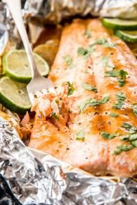 This Honey Teriyaki Lime Salmon Baked in Foil is a super easy dinner recipe you can whip up in under 30 minutes. You can either use homemade honey teriyaki sauce or store bought for an even quicker meal. Serve it with your favorite grain and/or veggie sides, for a clean eating, satisfying, healthy main meal the whole family will enjoy   on myrecipemagic.com