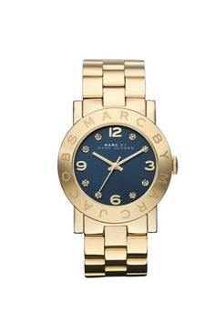Marc by Marc Jacobs Amy watch featuring stainless steel 36MM case with logo etched on topring. Stainless steel bracelet. Navy blue dial with gold hands and gold pave stones.