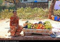 http://www.photaki.com/picture-young-fruit-seller-goa-india_988769.htm