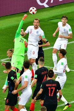 Croatia's goalkeeper Danijel Subasic punches the ball as England's forward Harry Kane looks on during the Russia 2018 World Cup semifinal football...
