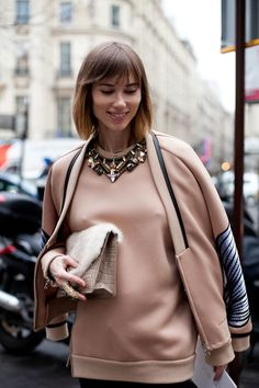 Anya Ziourova is just peachy with her statement necklace and sweatshirt dressing, thank you