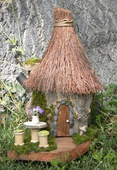 Fairy dream home.  The table and chairs are made of empty thread spools.