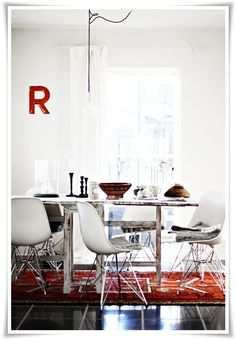 Nice rug and light fixture in this dining room.