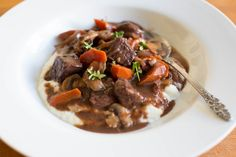 """Julia Child introduced this traditional French beef stew to the American masses in  'Mastering the Art of French Cooking', and describes this dish as """"one of the most delicious beef dishes concocted by man.""""    The name of this recipe denotes its origins — the Burgundy region of France (Bourgogne in French), which of course, is also the home of some of the best full-bodied red wines in the world.    Traditional boeuf a la Bourguignonne is braised slowly in that wine, which not only imparts…"""