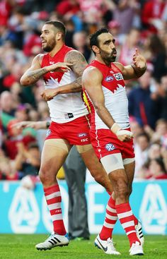 Lance Franklin (L) of the Swans celebrates with Adam Goodes (R) after kicking a goal during the round 13 AFL match between the Sydney Swans ...