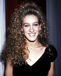 When it came to hair in the '80s, bigger was always better! Long before Sarah Jessica Parker's role as the chic Carrie Bradshaw, the star went for volumized ringlets with a mini-poof...   ~D~