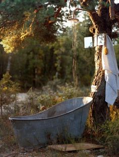 Who needs a swimming pool. Just one lovely bathtub outdoors will do..