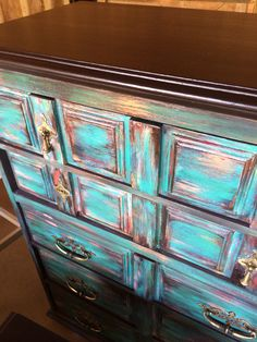 Layers of Annie Sloan chalk paint and Modern Masters Metal copper.  General Finishes Java Gel on top.