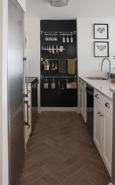 Small kitchen design ideas. Use illusion. Make your kitchen appear longer with floor tiles placed on a diagonal.
