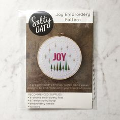 """Practice and perfect your hand-stitching skills when you whip up this original, modern holiday embroidery design by Salty Oat. The Joy hand embroidery pattern is perfect for beginning and experienced stitchers alike, and can be personalized with your favorite colors, threads, and stitches. Its an excellent gift for crafty friends, or could be stitched, framed, and gifted for a house warming, the holidays, or just because.  WHATS INCLUDED •An 8"""" x 8"""" linen-cotton canvas panel, with the Joy…"""