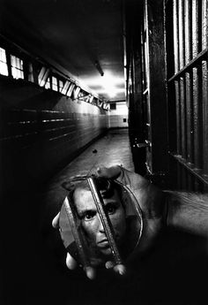© Sean Kernan, 1979, Prisoner with mirror In 1977, Mr. Kernan was photographing a personal project on carnival workers in Ohio and West Virginia...