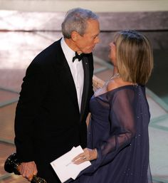 Barbara Streisand Photos Photos - *EMBARGOED FROM ONLINE USAGE OR PUBLICATION UNTIL END OF LIVE TELECAST* Actor/director Clint Eastwood is congratulated by Barbra Streisand after winning the oscar for best picture for 'Million Dollar Baby' during the 77th Annual Academy Awards on February 27, 2005 at the Kodak Theater in Hollywood, California. - The 77th Annual Academy Awards - Show
