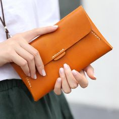Overview:   Design: Handmade leather long wallet In Stock:  Made to order (2-6 days) Include: Long Wallet Color: Orange, Red Material: Cowhide Measures: 19cm x 11cm x 2cm  Weight: 0.15kg Slots: 1 full...