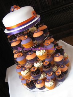 Purple and Orange Wedding Cupcake Tower by SugarplumB.deviantart.com on @deviantART