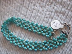 Turquoise and silver beaded bracelet by ontheroadcreations on Etsy, $28.00
