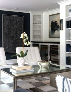 color scheme, metal and mirror table, white leather chairs, wine cooler with artwork