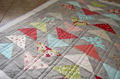 straight line quilting tutorial. she also has a great tutorial on where to buy quilting fabric.