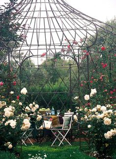 Backyard Landscaping Ideas Garden Structure Wire Gazebo: Open and airy, yet offering a sense of enclosure, this fabulous metal onion-dome structure is a magical place to enjoy meals or drinks with friends and family. For flower lovers, a wire gazebo is also a perfect place to train fragrant climbing roses.