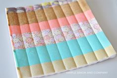 Use this tutorial to learn to quilt! Make some quilted pot holders and use this easy quilt binding tutorial....
