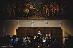 The paintings in the RSA, London provide a stunning backdrop for the speakers at the top table during this wedding reception.