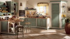This traditional kitchen can be fitted with a system of masonry walls and work-tops that transforms the most characterless space into a complex combination of intriguing forms. Real architectural structures, which can be used to build the units' supporting structures, with plaster or rough finish varnished surfaces or finished with rustic-look ceramic tiles. Anticato antique green.