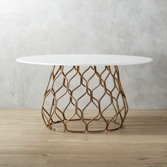 Shop circuit dining table.   A functional piece of art for your dining room.  Sculptural base of iron rod and tubing is bent and welded into an abstract hive-like form finished with the look of antiqued brass.