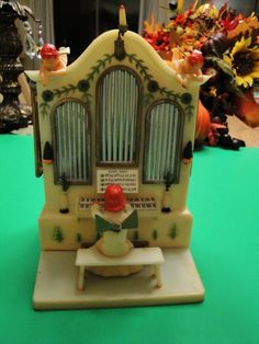 Vintage Music Box....I used to play with one like this at my grandmas house...it was a bluish color I think!  It plays Silent Night.