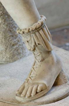 Foot detail of Artemis of the Rospigliosi type. Marble, Roman artwork of the Imperial Era, 1st–2nd centuries CE. Copy of a Greek original, maybe the the bronze group mentioned by Pausanias (I, 25, 2), which represented a gigantomachia.