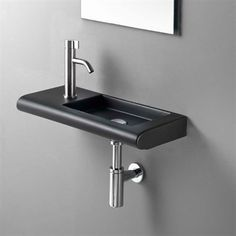 Curvet SX håndvask med lille bordpade til venstre i flot design.