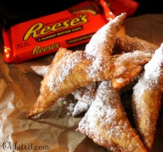 Reese's Ravioli! Reese's PB Cups wrapped in wontons, deep fried and sprinkled with icing sugar! YUMMY!!