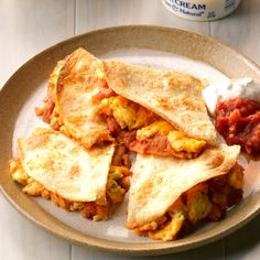 Here's my fun spin on breakfast for dinner. These egg quesadillas are so easy to make, full of protein and plain delicious any time of day. —Barbara Blommer, Woodland Park, Colorado Cheesy Eggs, Breakfast For Dinner, Brunch, Woodland Park, Quesadillas, Spin, Ethnic Recipes, Easy, Colorado