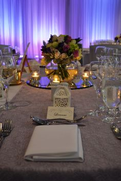 Mauve lace runner with mauve and cream floral centrepiece. Styled by Greenstone Events.