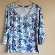 Pullover print top. Three quarter length sleeve pullover top. Scoop neck, print design. Gently worn. Studio works Tops