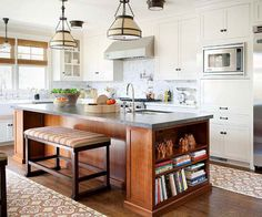 Mismatched Cabinets I love how the bookcases on the ends make this island look more like a piece of furniture than cabinets.