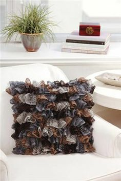Ruffle Pillow - Add some texture to your room with this great ruffle yarn. It can be a statement piece or add some extra detailing