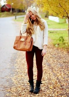 Cream sweater, burgundy skinnies, black biker boots and camel bag.
