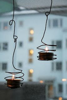 easy to make - hanging wire candle holders. Buy tie-wire at the hardware store
