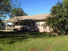Great Starter Home or Investment Property! 3 bedroom, 1 bath brick home with beautiful hardwood flooring! Spacious Living Room and eat in kitchen. Convenient to schools and shopping. Priced to Sell! in Savannah TN