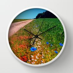 Summer flowers along the trail Wall Clock