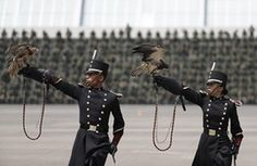 Mexico City  Soldiers carry eagles during a graduation ceremony for cadets at a military academy Photograph: Rebecca Blackwell/AP